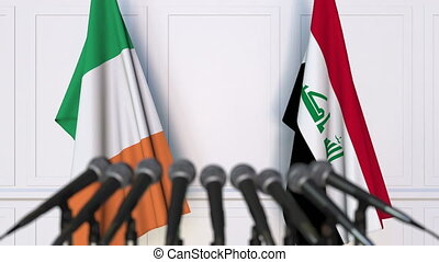 Flags of Ireland and Iraq at international meeting or...