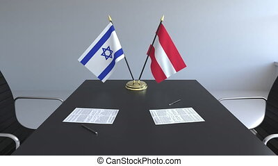 Flags of Israel and Austria and papers on the table....