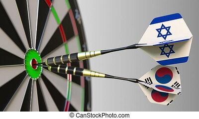 Flags of Israel and Korea on darts hitting bullseye of the target. International cooperation or competition animation