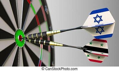 Flags of Israel and Syria on darts hitting bullseye of the...