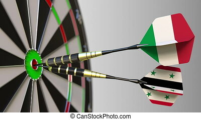 Flags of Italy and Syria on darts hitting bullseye of the...