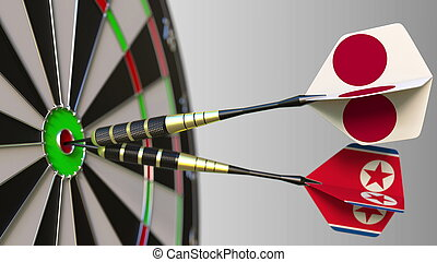 Flags of Japan and North Korea on darts hitting bullseye of the target. International cooperation or competition conceptual 3D rendering