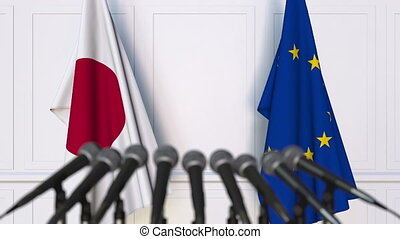Flags of Japan and the European Union at international meeting or negotiations press conference