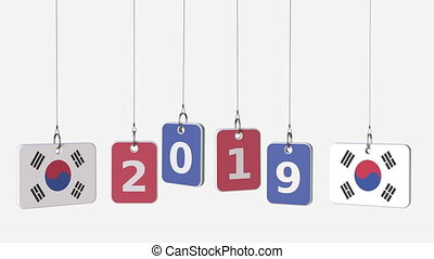 Flags of KOREA and 2019 text on hanging plates. Alpha matte...