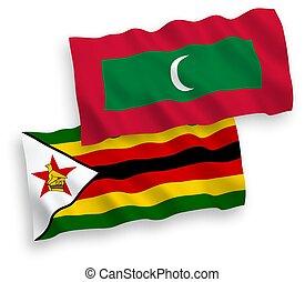 Flags of Maldives and Zimbabwe on a white background - ...