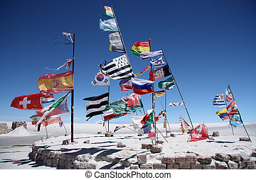 Flags of many countries in Uyuni