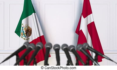 Flags of Mexico and Denmark at international meeting or...
