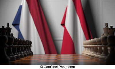 Flags of Netherlands and Austria behind pawns on the ...