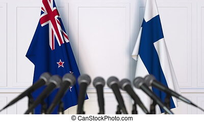 Flags of New Zealand and Finland at international meeting or...