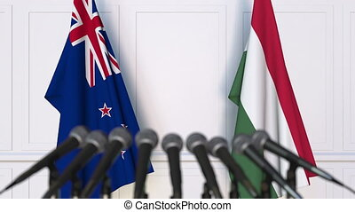 Flags of New Zealand and Hungary at international meeting or...