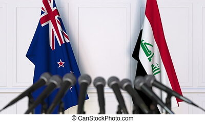 Flags of New Zealand and Iraq at international meeting or...
