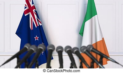 Flags of New Zealand and Ireland at international meeting or...