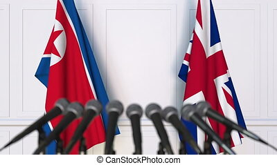 Flags of North Korea and The United Kingdom at international...
