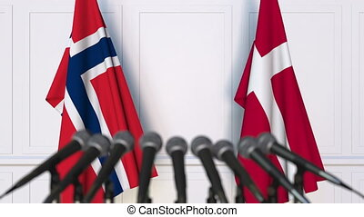 Flags of Norway and Denmark at international meeting or...