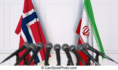 Flags of Norway and Iran at international meeting or...