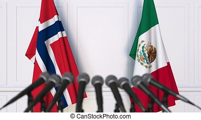 Flags of Norway and Mexico at international meeting or...