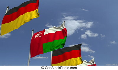 Flags of Oman and Germany at international meeting, loopable...