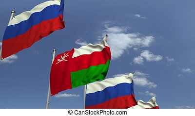 Flags of Oman and Russia at international meeting, loopable...