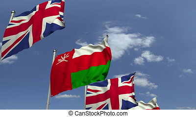 Flags of Oman and the United Kingdom at international...
