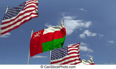 Flags of Oman and the USA at international meeting, loopable...