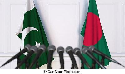 Flags of Pakistan and Bangladesh at international meeting or...