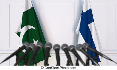 Flags of Pakistan and Finland at international meeting or...