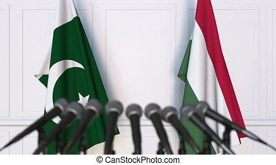 Flags of Pakistan and Hungary at international meeting or...