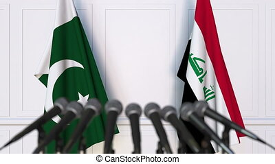 Flags of Pakistan and Iraq at international meeting or...