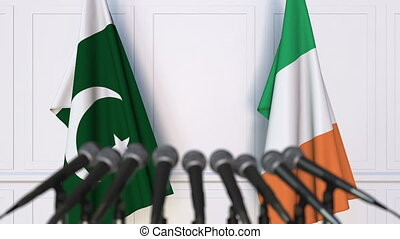 Flags of Pakistan and Ireland at international meeting or...