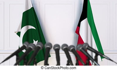 Flags of Pakistan and Kuwait at international meeting or...