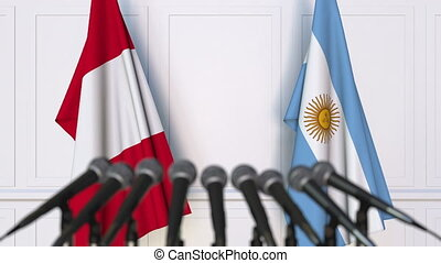 Flags of Peru and Argentina at international meeting or...