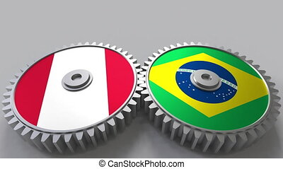Flags of Peru and Brazil on meshing gears. International...