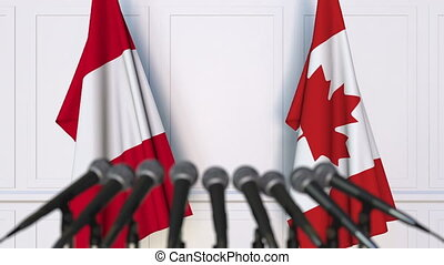 Flags of Peru and Canada at international meeting or...