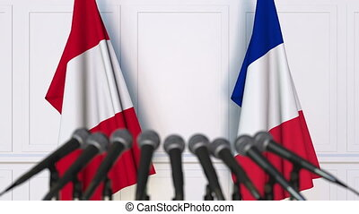 Flags of Peru and France at international meeting or...