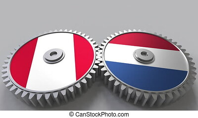Flags of Peru and Netherlands on meshing gears....