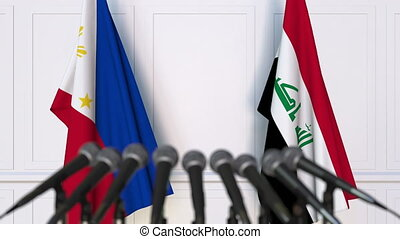 Flags of Philippines and Iraq at international meeting or...