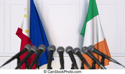 Flags of Philippines and Ireland at international meeting or...