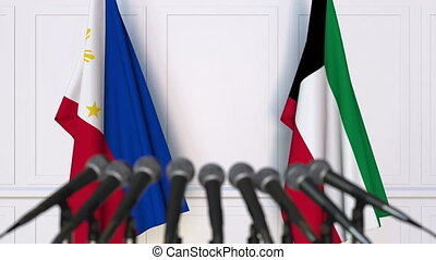 Flags of Philippines and Kuwait at international meeting or...