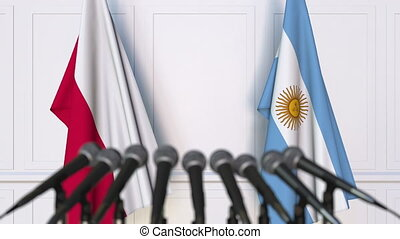 Flags of Poland and Argentina at international meeting or...