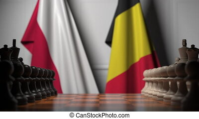 Flags of Poland and Belgium behind pawns on the chessboard. Chess game or political rivalry related 3D animation