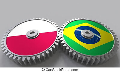 Flags of Poland and Brazil on meshing gears. International...