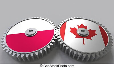 Flags of Poland and Canada on meshing gears. International...