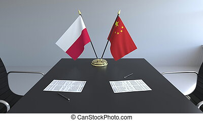 Flags of Poland and China and papers on the table. Negotiations and signing an international agreement. Conceptual 3D rendering