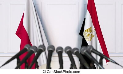 Flags of Poland and Egypt at international meeting or...