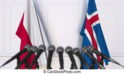 Flags of Poland and Iceland at international meeting or...