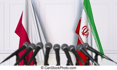 Flags of Poland and Iran at international meeting or...