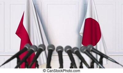 Flags of Poland and Japan at international meeting or...