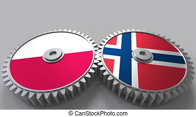 Flags of Poland and Norway on meshing gears. International...