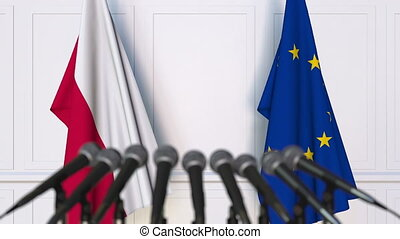 Flags of Poland and the European Union at international meeting or negotiations press conference