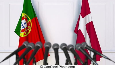 Flags of Portugal and Denmark at international meeting or...